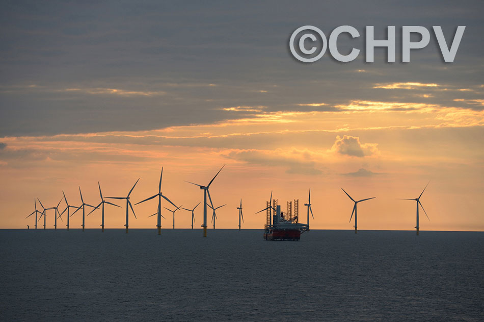 sunset behind the completed windfarm